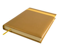 Gold notebook. Isolated on white Stock Image