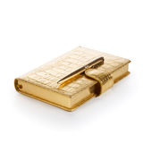 Gold Notebook with Pen Stock Photography