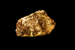 Gold nugget on black background. Royalty Free Stock Photo