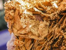 Gold Nugget with brilliant layers of Dendrtic gold. royalty free stock images
