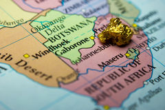Gold nugget and map of South Africa Royalty Free Stock Photo
