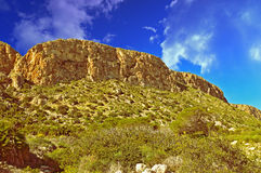 Gold Nugget Rock. Dramatic Cliff And Sky royalty free stock image
