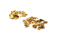 Gold Nuggets. Gold in nugget form mined from the rivers and streams of California isolated on white Royalty Free Stock Image