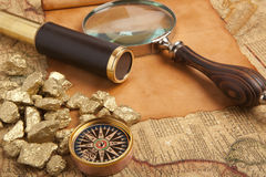 Gold nuggets on antique map Stock Photo