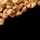 Gold nuggets on black background. Stock Image