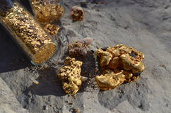 Gold nuggets and flakes Royalty Free Stock Photo