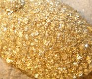Gold nuggets found by prospectors in the mine Royalty Free Stock Photos