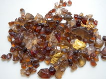 Gold nuggets & natural Zircons Royalty Free Stock Photography
