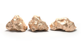 Gold nuggets on a white background. Royalty Free Stock Photos