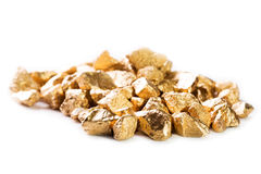 Gold nuggets on white background. Royalty Free Stock Photos