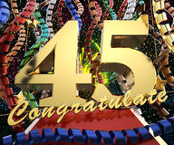 Gold number forty five with the word congratulate on a background of colorful ribbons and salute. 3D illustration.  Stock Photography