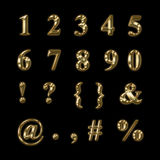 Gold numbers, punctuation and symbols Stock Image