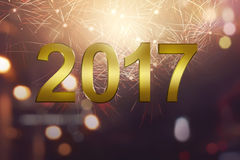 2017 gold numbers with sparkle firework. On blurred background Royalty Free Stock Photography