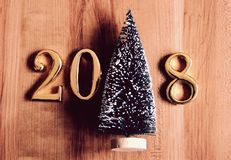 Gold 2018 and christmas tree decoration. Royalty Free Stock Photos
