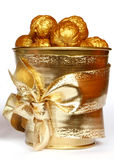 Gold nuts. Little pail with golden nuts Stock Photography