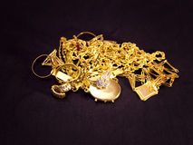 Gold objects. Beautiful rings, necklaces, earrings, pendants and medallions made of real gold,photography Stock Images