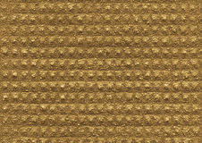 Gold, ochre texture of the porous relief material. Is close-up. Abstract wall surface background for design Royalty Free Stock Photos