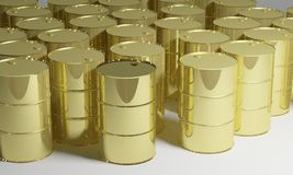 Gold oil barrels Royalty Free Stock Photos