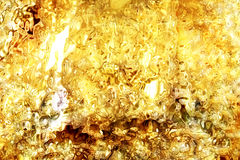 Gold oil liquid background Royalty Free Stock Image