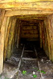 Gold - old roman tunnel in gold mine Rosia Montana, Transylvania. Rosia Montana is a commune of Alba County in the Apuseni Mountains of western Transylvania Stock Photo