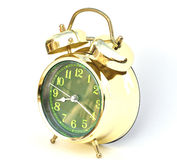 Gold old style alarm clock Royalty Free Stock Image