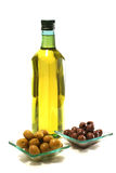 Gold olive oil in buttle over white Royalty Free Stock Image
