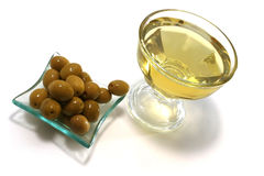 Gold olive oil with green olives Stock Images