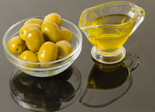 Gold olive oil with green olives Royalty Free Stock Images