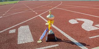 Gold One Trophy, track running, gold trophy cup Running race lane royalty free stock images