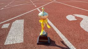 Gold One Trophy, track running, gold trophy cup Running race lane stock photo