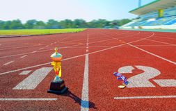Gold One Trophy, track running, gold trophy cup Running race lane. Sport royalty free stock photography