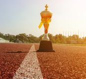 Gold One Trophy, track running, gold trophy cup Running race lane royalty free stock photography