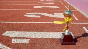 Gold One Trophy, track running, gold trophy cup Running race lane. Sport stock photography