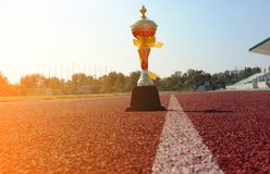 Gold One Trophy, track running, gold trophy cup Running race lane stock images