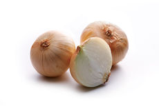 Gold onion vegetable bulbs. On white background Royalty Free Stock Images