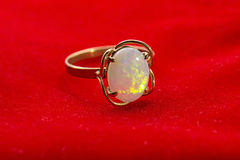 Gold Opal Ring on Red Velvet stock image