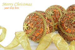 Gold and orange Christmas decorations. On white background with space for your text Stock Photos