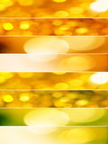 Gold and orange Christmas lights. Vertical composition divided in eight horizontal lines with abstract sparkling textures in yellow, orange and green tones Stock Photography