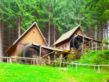 Gold ore mills. Medieval wooden water mills in Zlate Hory, Czech Republic Stock Photo