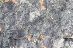 Gold ore texture. Gray stone background. The surface of the marble with a brown. Tint stock image