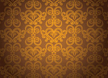 Gold ornamental pattern. Luxury gold ornamental pattern on a brown background Stock Photo