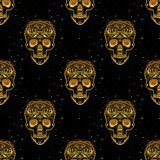 Gold ornamental sugar skull seamless pattern. Stock Photography