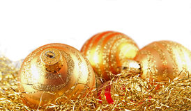 Gold Ornaments. Gold Christmas ornaments nested in confetti stock photography