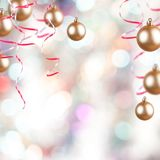 Gold ornaments. Golden Christmas ornaments on a Christmas background Stock Images