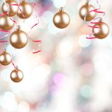Gold ornaments. Golden Christmas ornaments on a Christmas background Stock Photo
