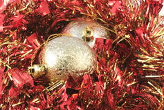 Gold ornaments and red garland Stock Photography