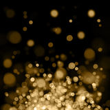Gold out of focus spotlights. Abstract background of flying up golden spotlights Stock Images