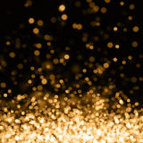 Gold out of focus spotlights. Abstract background showing many out of focus spotlights flying up Royalty Free Stock Images