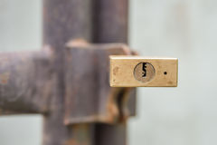 Gold padlock lock on house gate, can see keyhole Royalty Free Stock Photos