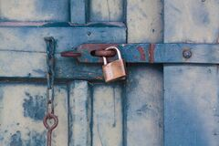Gold Padlock Locking Door Royalty Free Stock Photo